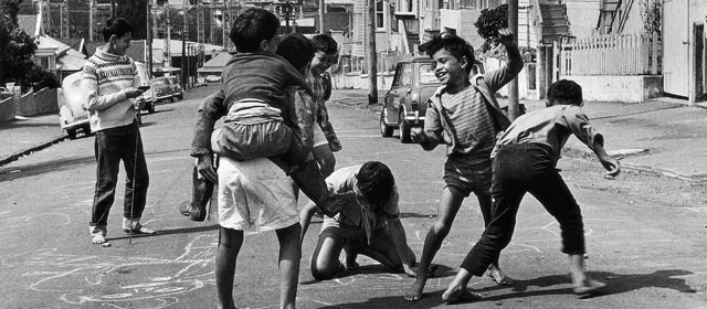 Playing on the street, Ponsonby, Auckland, 1971